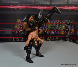 WWE Elite 45 Roman Reigns figure review - piledriving Seth Rollins