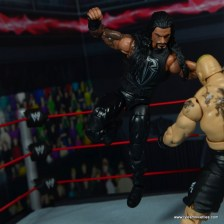 WWE Elite 45 Roman Reigns figure review - sky high Superman Punch to Lesnar