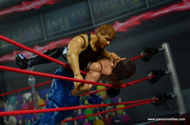 wwe network spotlight dean ambrose figure review -clotheslining aj styles over the ropes