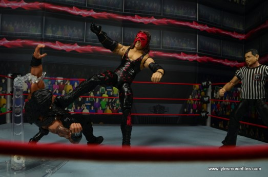 wwe elite 47b kane figure review -stomping down roman reigns