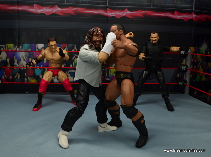 wwe summerslam elite mankind figure review - attacking the rock while the corporation runs in