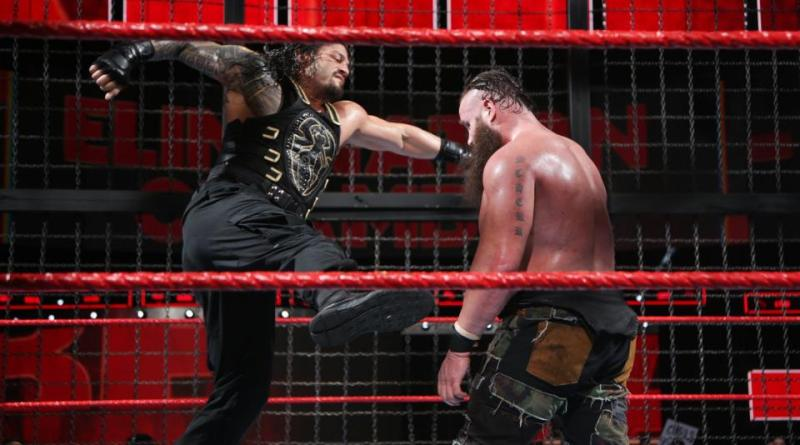 wwe elimination chamber 2018 - roman reigns punches braun strowman