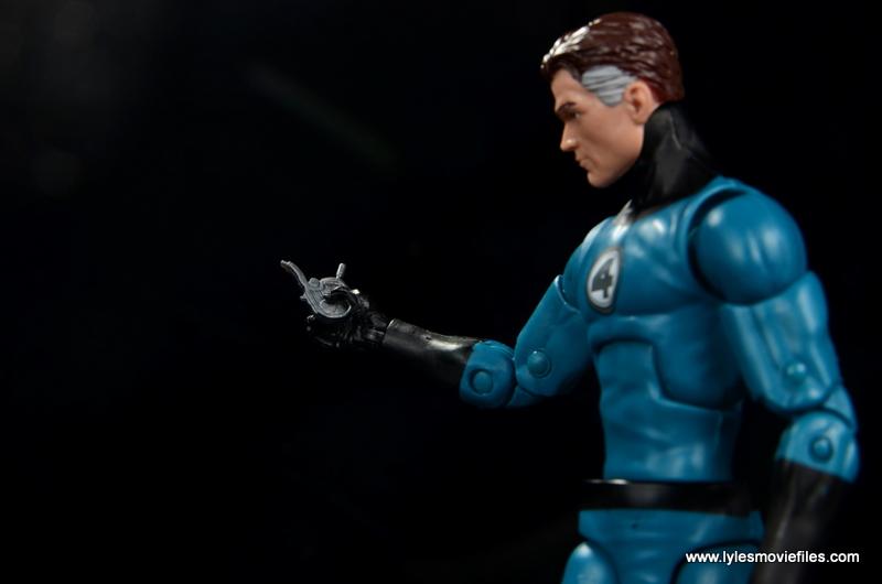 marvel legends mister fantastic figure review - holding ultimate nullifier