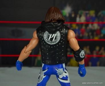 wwe elite 56 aj styles figure review - hood down vest detail