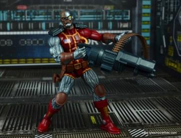 marvel legends deathlok figure review - holding rail gun