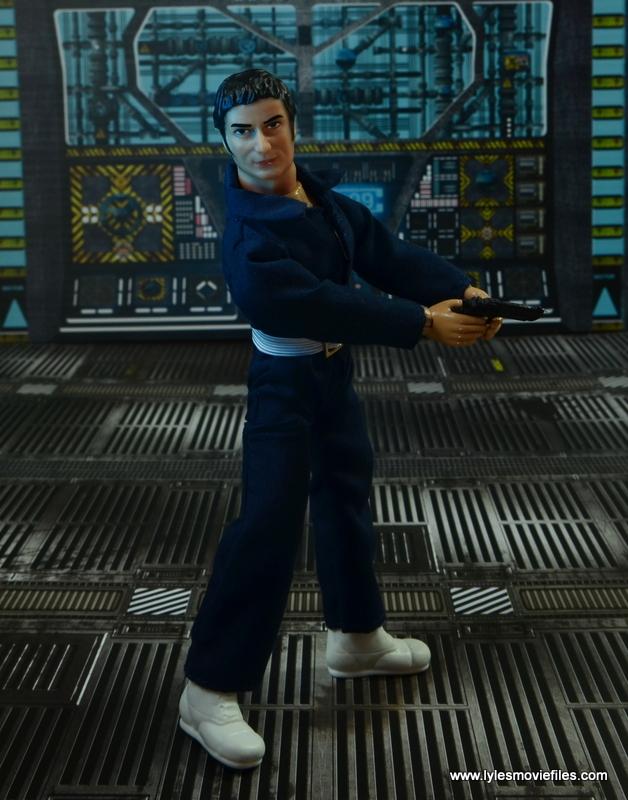 mego action jackson figure review - holding gun