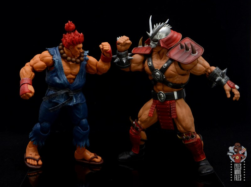 storm collectibles mortal kombat shao khan figure review - facing off with akuma