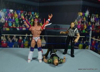 WWE Flashback Ultimate Warrior figure review -celebrating over sgt. slaughter