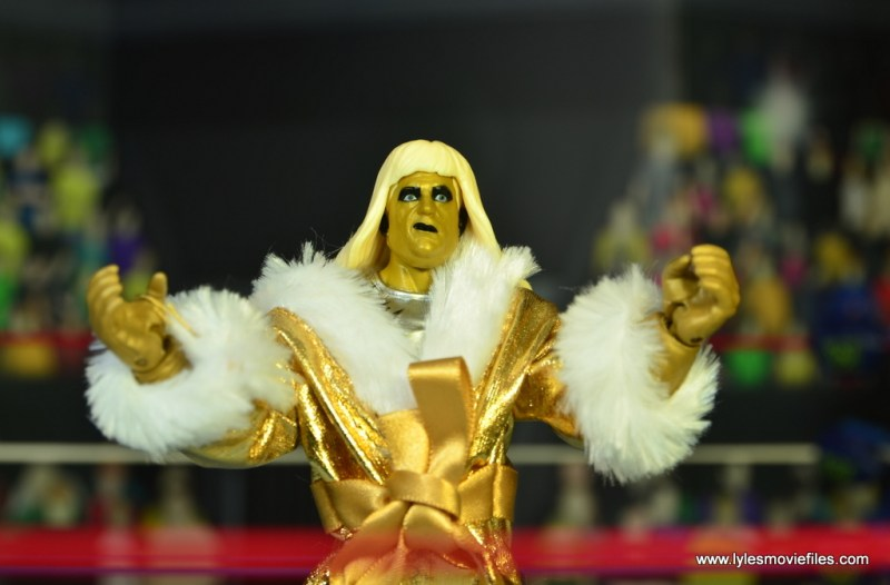 WWE Goldust figure review - arms up with robe on