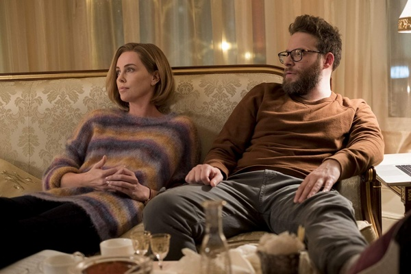 long shot review - charlize theron and seth rogen sitting
