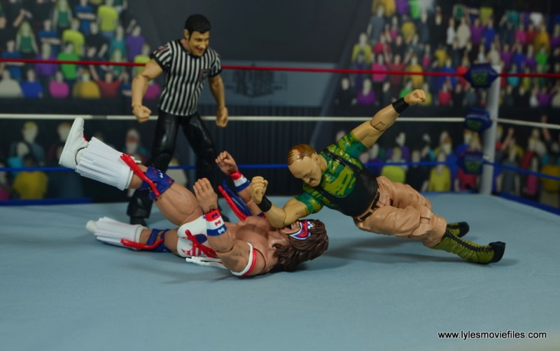 WWE Basic Sgt. Slaughter figure review - dropping the elbow to ultimate warrior