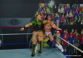 WWE Basic Sgt. Slaughter figure review - elbowing ultimate warrior in corner