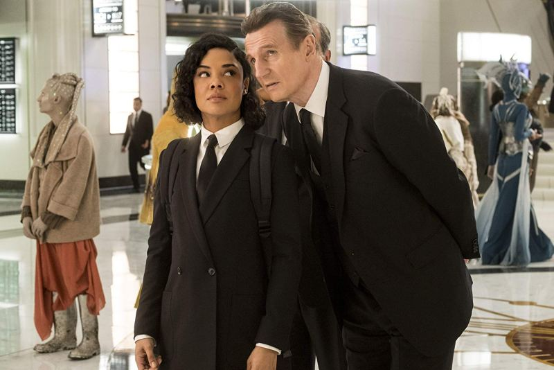 men in black international review - tessa thompson and liam neeson