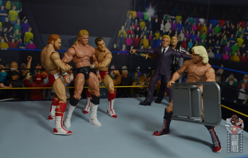 wwe build-a-figure jj dillon figure review - holding the ref back while horsemen attack luger