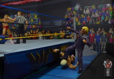 wwe build-a-figure jj dillon figure review - stomping dusty rhodes outside