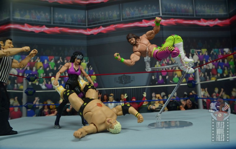 wwe elite sensational sherri figure review - holding dusty rhodes while macho king drops elbow