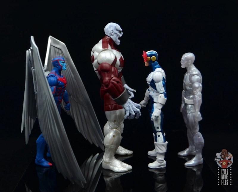 marvel legends build a figure caliban figure review -facing archangel, cyclops and iceman