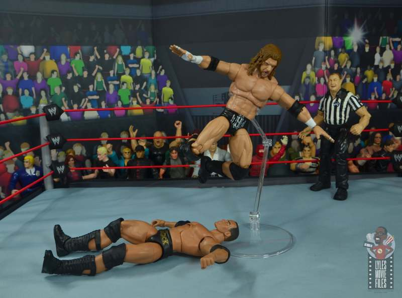 wwe ultimate edition triple h figure review - high kneedrop to the rock