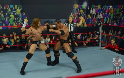 wwe ultimate edition triple h figure review - punching the rock