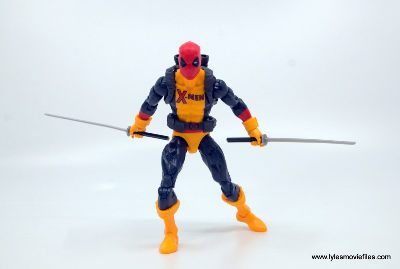 marvel legends deadpool figure review - coming forward with swords