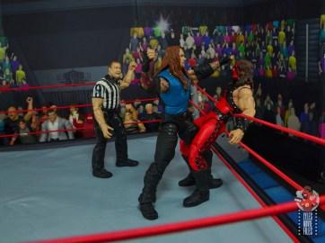 wwe elite 68 american badass undertaker figure review - punching kane in ropes