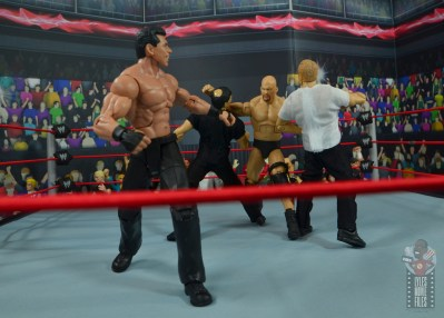 wwe elite gerald brisco figure review -getting clotheslined as mcmahon runs
