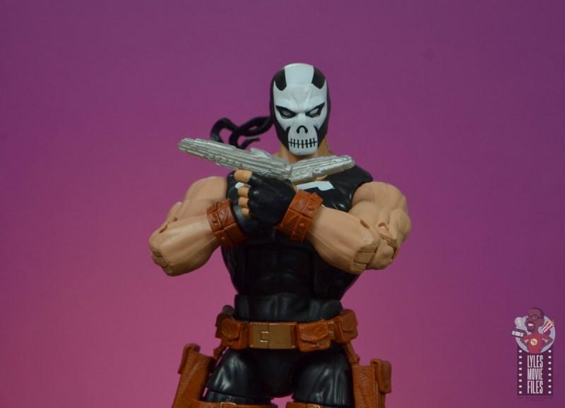 marvel legends crossbones figure review - holding smaller blasters