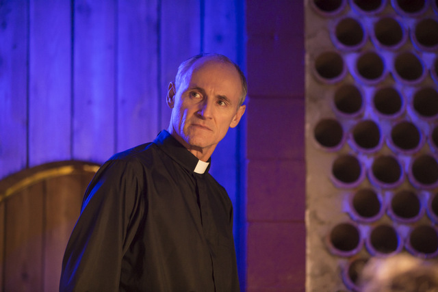 beast within review - colm feore as father roman