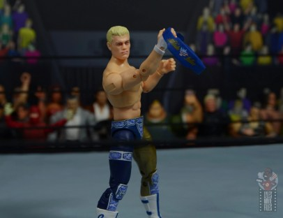 aew unrivaled cody figure review - holding weight belt