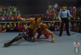 wwe legends 8 jake the snake roberts figure review - elbow smash on ricky steamboat