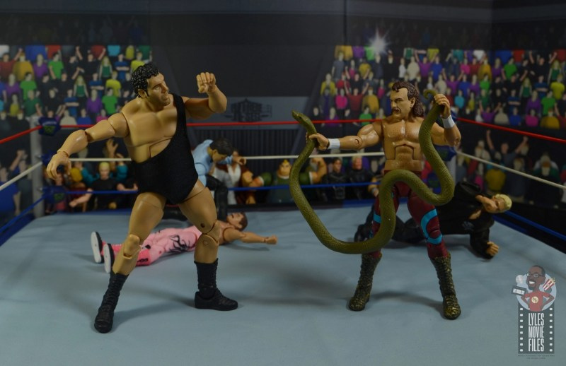 wwe legends 8 jake the snake roberts figure review - getting help from damien against andre the giant