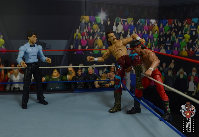 wwe legends 8 jake the snake roberts figure review - kneelift to ricky the dragon steamboat