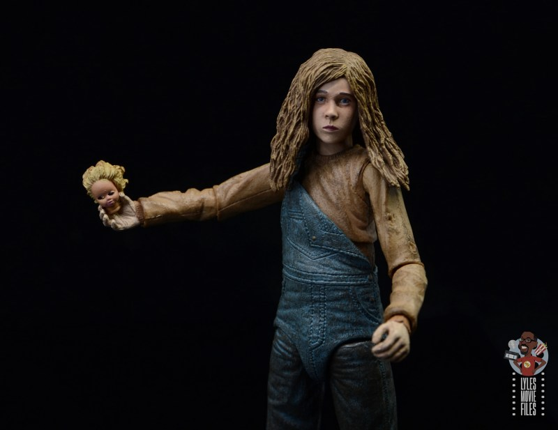 neca aliens newt figure review - holding doll head