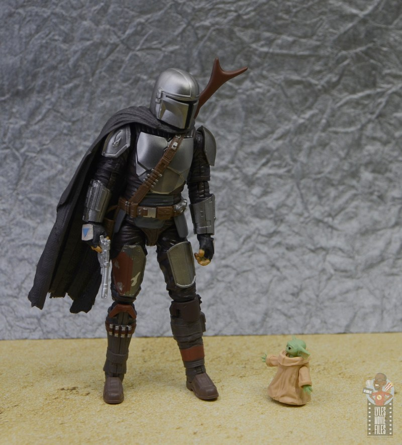 star wars the black series the child figure review - looking up at the mandalorian