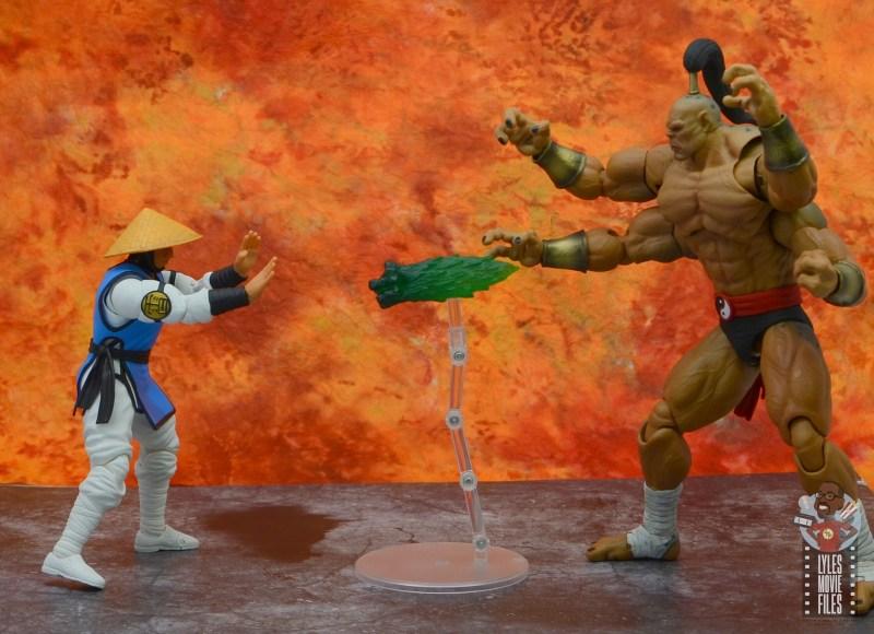 storm collectibles mortal kombat goro figure review - throwing fireball at raiden