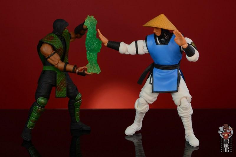 storm collectibles mortal kombat reptile figure review - blocking raiden strike