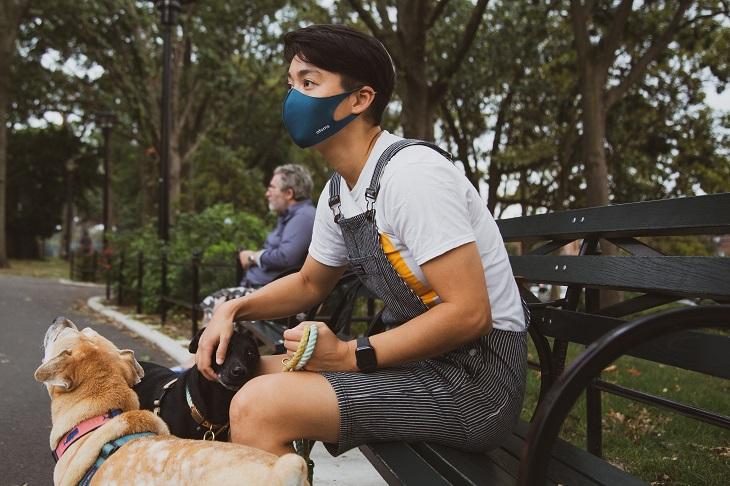 man wearing mask with dog