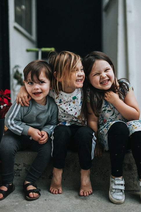 three children sitting together