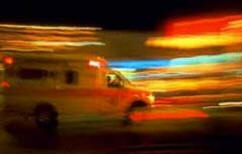Ambulance lights flashing in the darkness