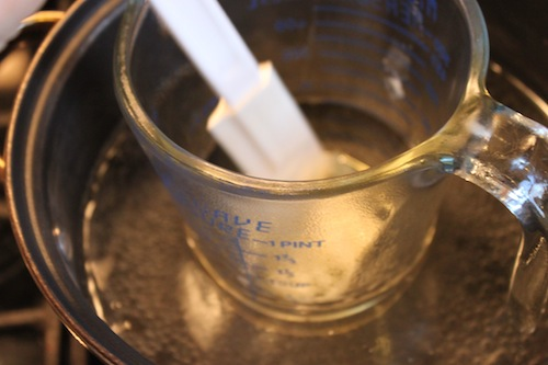 Stirring oils and butter while in hot water bath