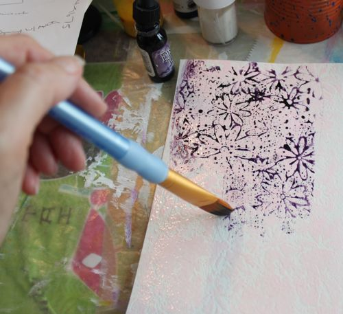 Spreading the ink with a water-filled brush