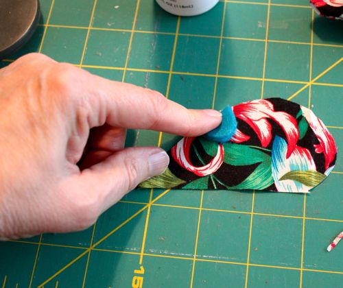 Attaching ears to fabric with glue