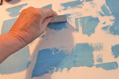 Spreading paint over paper