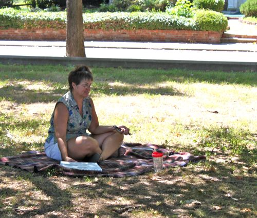 Carla sketching under the trees
