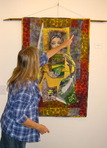 Penny Sisto with one of her quilts