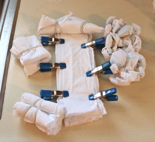 Some of the fabric tied and wrapped ready for the indigo dye bath