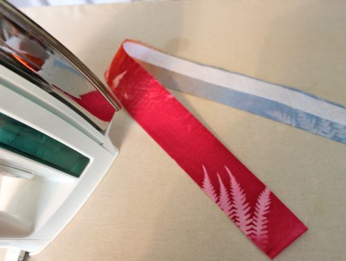 Ironing fusible to wrong side of fabric strip