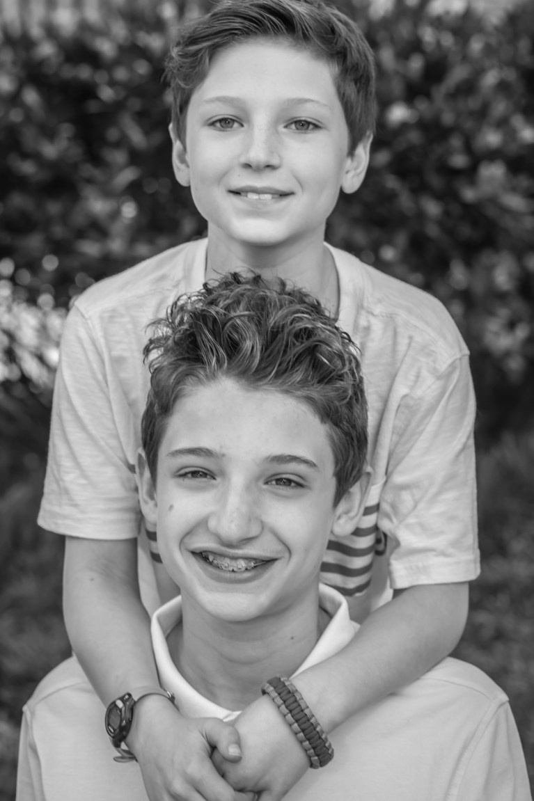 Even the biggest boulders cannot knock down two brothers holding each other up at their crystal city family session