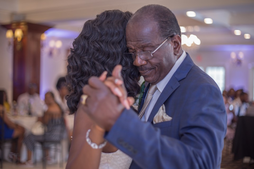 the bride and her father dancing during the reception at the Woodwinds