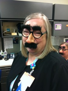 image of author Lynette M Burrows with Groucho mask